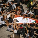 Mourners carry the body of Palestinian militant Marwan Sleem during his funeral in the central Gaza Strip