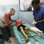 A Palestinian boy, who medics said was wounded in Israeli air strikes on a house, is being treated at a hospital in Khan Younis in the southern Gaza Strip