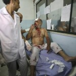 Palestinian man, who medics said was wounded in Israeli air strike, arrives at hospital in Khan Younis in southern Gaza Strip
