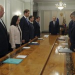 Russia's President Putin and other high-ranked officials observe a minute of silence for victims of Malaysia Airlines Boeing 777 plane crash before a meeting on economic issues at Novo-Ogaryovo state residence outside Moscow